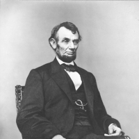 Abraham Lincoln, three-quarter length portrait, seated, facing right; hair parted on Lincoln's right side. Berger, Anthony, b. 1832, photographer. [1864 Feb. 9, printed later], Prints and Photographs Division Library of Congress. http://hdl.loc.gov/loc.pnp/ppmsca.19305