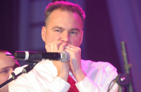 Governor-elect Tim Kaine plays the harmonica